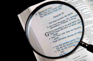 Bible examined under lens